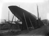 Yacht Britannia on stocks on the hard at Marvins Yard on the south coast, UK, in 1930 prior to being converted to a J-Class