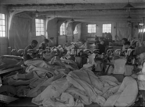 Hand sewing sails in Ratsey  Lapthorn Ltd on the south coast UK in 1930