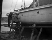 A large motor yacht with its hull being painted on a slipway at Mays Yard in Lymington (now known as Berthons) in 1939