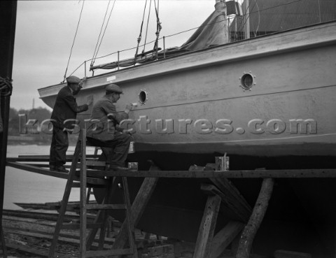 A large motor yacht with its hull being painted on a slipway at Mays Yard in Lymington now known as