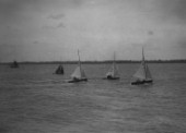 Int 14 dinghy racing off Cowes in the Solent,  sail numbers 111 and 177 visible