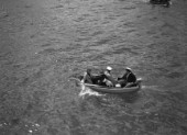 Spectators and a dog in a tender during the international mboat race in Torquay, 1938.