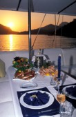 Set table on a sailing yacht during sunset