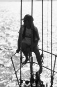 Girl relaxing on the bow of Swan 51 FORMOSA - the 1000th Swan built