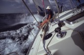 Man sitting on sailing yacht looking at view
