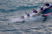 Canoe with outrigger racing, Hamilton Island, Australia.