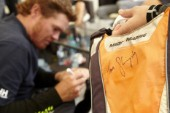 GC32 Austria Cup 2014, Gmunden, Lake Traunsee on May 28 – June 1, 2014. Tom Slingsby (AUS) signs a fans bag.
