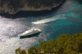 Aerial view of a superyacht and tenders and toys in the mediterranean sea