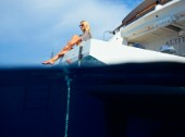 Woman sitting on beach deck of a superyacht