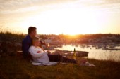Couple relaxing on blanket in the sunset
