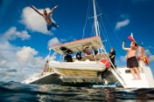 Matt Edney jumps off the swim platform of a catamaran while at anchor in the British Virgin Islands on Sunday, January 8th, 2012