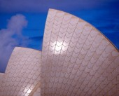 The roof or sails of the Sydney Opera House against a bright blue sky. 1999