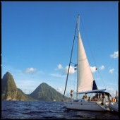 SOUFRIERE, ST. LUCIA - MARCH 2006:  A sailboat returns to Soufriere harbor, with the landmark Piton mountains looming in the background. (Petit Piton at left, Gros Piton at right.)  (Photo by Katja Heinemann/Aurora)