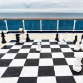 Giant chess board on the deck of a cruise ship.