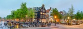 Corner of Prinsengracht and Blauwburgwal at night, Amsterdam, North Holland, Netherlands
