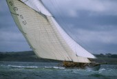 A beautiful classic yacht, an 85 gaff rigged sloop races in the Americas Cup, where the dark skies of Cowes, England predict stormy seas.