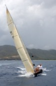 The 6 Meter Nada. crshes through the waves upwind at the Antigua Classic Regatta 2006.
