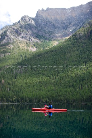 Andy Feuling and daughter River paddle their kayak on Bowman Lake in   Glacier National Park Montana