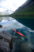 Andy Feuling paddles his kayak alone on Bowman Lake in Glacier National Park, Montana.
