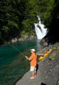 George Bahm enjoys fly fishing during a wilderness adventure in Futaleufu, Chile.