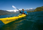 Jonathan Eisenberg paddles a sea kayak during a wilderness adventure in Lago Yelcho, Chile.
