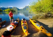 Mike Powers looks over his gear during a kayaking adventure in Lago Yelcho, Chile.