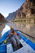 Dana Johnson paddling an inflatable raft down Cataract canyon, Colorado river, Utah. Photo taken during a raft trip down the Colorado river from Moab to Lake Powell through Canyonlands National Park and Cataract canyon, Utah.