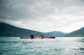 Sea kayaking on the turquoise waters of Norways largest fjord, the Sognefjord.