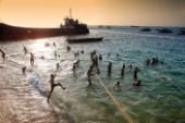 Children bathing on the beach. Stone Town. Zanzibar.