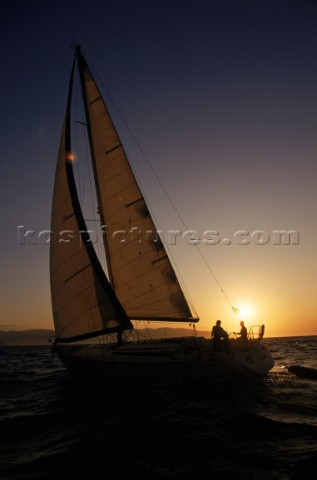 Sailing vessel at sunset Joanna B PinneoAurora PhotosKos Pictures