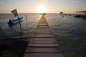 Belize, Central America - Sunrise at one of the many private, wooden piers on the Caye Caulker waterfront.