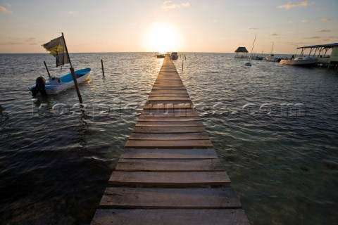 Belize Central America  Sunrise at one of the many private wooden piers on the Caye Caulker waterfro