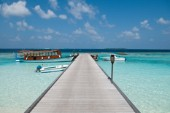 An empty wooden jetty and moored boats, Six Senses Soneva Fushi Resort, Kunfunadhoo Island, Baa (South Maalhousmadulu) Atoll, Maldives, on January 26th, 2010. Thomas Pickard/Aurora Photos/Kos Pictures