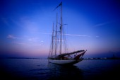 A classic yacht rests at anchor in the calm evening hours, Casco Bay, Portland, Maine. Peter Dennen/Aurora Photos/Kos Pictures